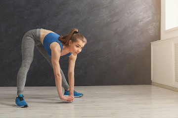 Fitness woman at stretching training at gym