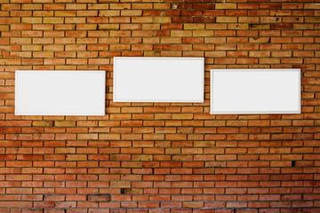 3 blank frame mock up on a brick wall.