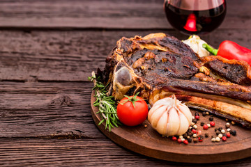 Beef steak with spices, vegetables and wine close