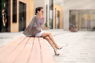 fashion woman sits outdoors in the city