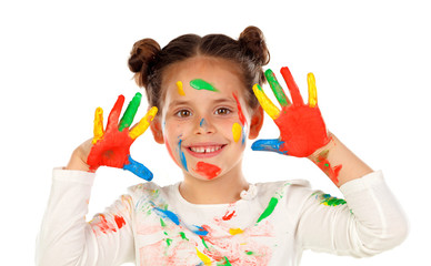 Funny girl with hands and face full of paint
