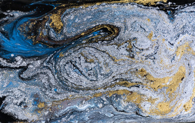 Marble abstract acrylic background. Nature blue marbling artwork texture. Gold and silver glitter.
