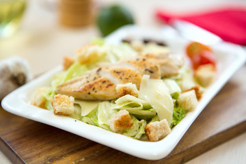 Homemade Vegetable salad with chicken and cheese on table