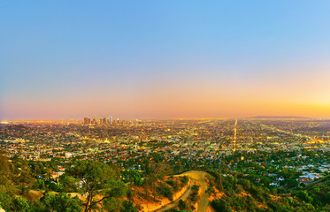 View of Hollywood Hill and city center of Los Angeles at sunset.
