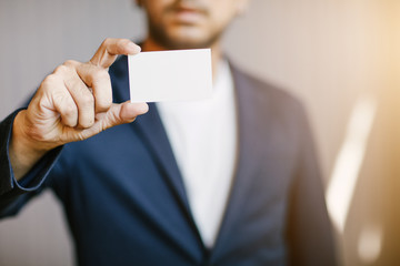 Man holding white business card,Man wearing blue shirt and showing blank white business card. Blurred background. Horizontal mockup, Smart asian business Person Professional Occupation cheerful