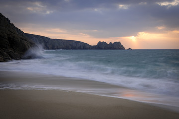 Porthcurno Beach at sunrise in West Cornwall.