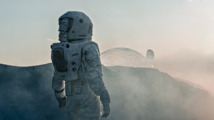 Shot of the Astronaut on Red Planet Watching Toward His Base/Research Station. Near Future First Manned Mission To Mars, Technological Advance Brings Space Exploration, Colonization. Fototapete