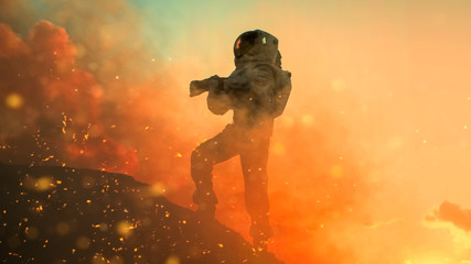 Silhouette of the Astronaut Takes Air Tests on the Rocky Mountain of the Alien Planet During Fire Storm. First Manned Mission on Venus. Space Exploration, Colonization.