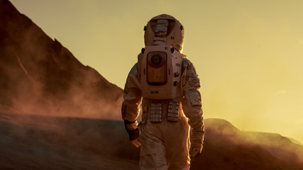 Zelfklevend Fotobehang Diepbruine Shot of Astronaut Confidently Walking on Mars. Red Planet Covered in Gas and Smoke. Humans Overcoming Difficulties. Big Moment for the Human Race.