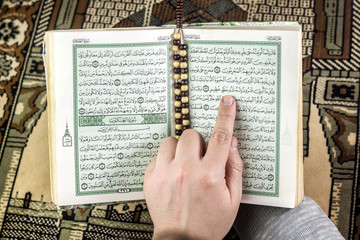 Holly Quran with rosary