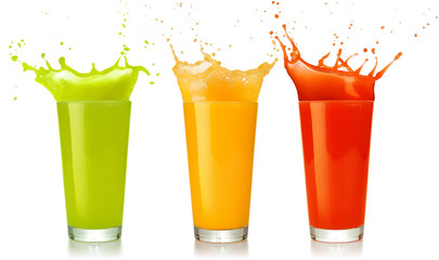green, yellow and red juice glasses splashing isolated on white