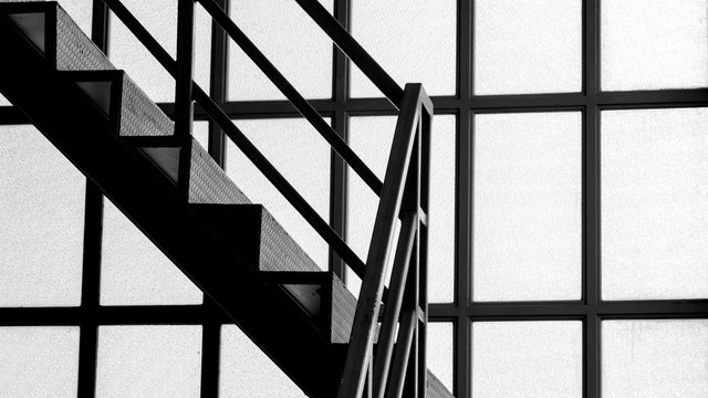 metal staircase near the glass window - close up
