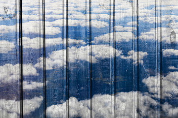 unique structure, wooden background and clouds