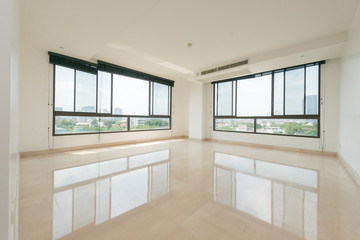 Empty bright living room without furniture