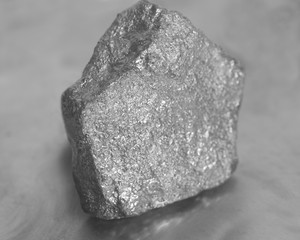 Silver nugget on gray background