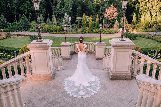 bride chic dress architecture lanterns  beautiful garden
