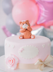 festive pink cake with bow bear top