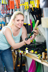 Woman in shop with gardening tools