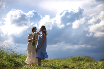 Young girls are walking in the field