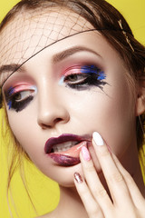 Dramatic Fashion Look young Woman. Beautiful Model with bright Make-up. Makeup style for Halloween