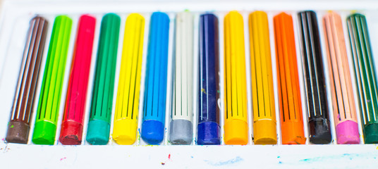 Colored crayons in a box