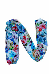 Isolated English flower alphabet is made of fabric with floral print