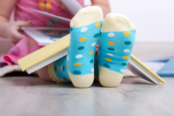 child's feet reading books