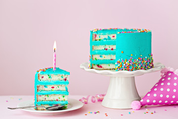 Colorful birthday cake with one candle