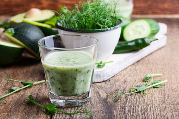 Green pear sprouts, fresh vegetables and smoothie for healthy meal