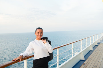 Fashion, beauty, look. Happy woman with business jacket on shipboard in miami, usa. Travelling for business. Sensual woman smile on ship board on blue sea. Wanderlust, adventure, discovery, journey