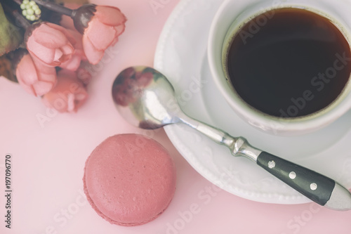 Pink macaron macaroon spring flowers and coffee pastel background pink macaron macaroon spring flowers and coffee pastel background top view negle
