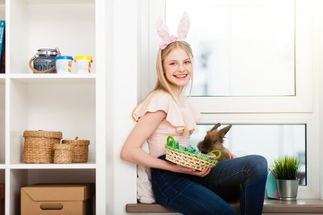 Teenage girl holding Easter eggs