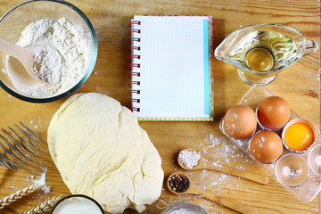 Ingredients for dough, cooking bread, pizza or pie, pasta, including flour, eggs, milk, on wooden rustic background, empty space for text, top view, set