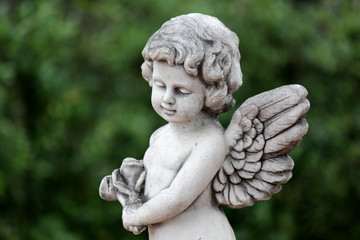 statue of an cute infant angel (cupid)
