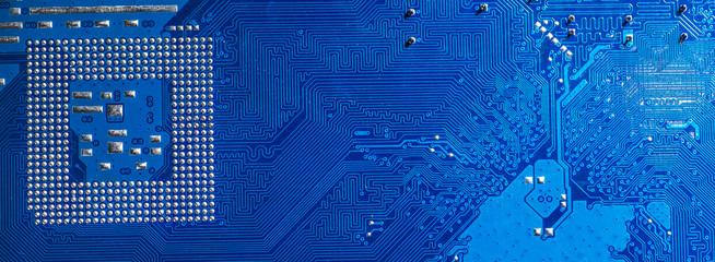blue circuit board background of computer motherboard