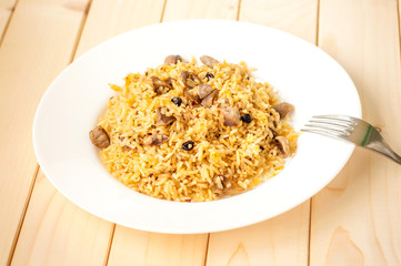 Rice cooked with meat, vegetables and spices. Uzbek traditional dish plov.