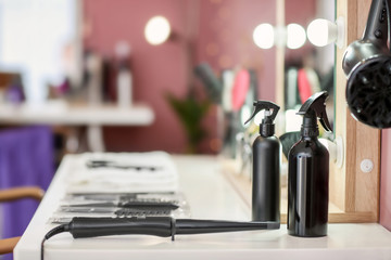 Hairdresser tools on table in salon