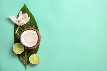 Composition with coconut water and fresh nuts on color background, top view
