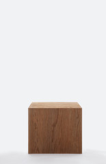 Isolated dark solid wood cube on white background and huge copyspace