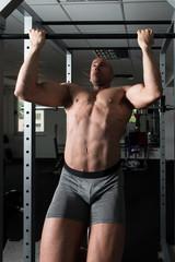 Man Doing Pull Ups Best Back Exercises