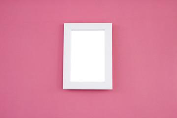 White frame mock up on pink background.