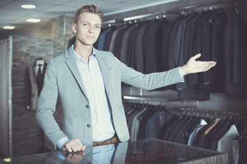 man selling business clothes in the store