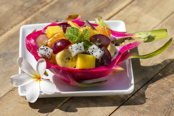 Fresh tropical fruit salad in dragon fruit skin - healthy breakfast, weight loss concept. Thailand