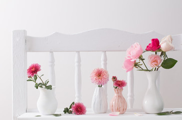 pink roses on vintage wooden white shelf