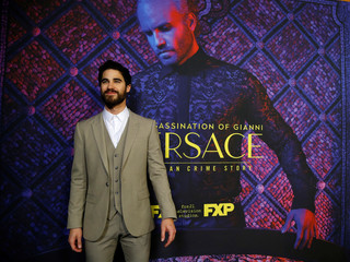 "Cast member Criss poses at a panel event for ""The Assassination of Gianni Versace: American Crime Story"" in Los Angeles"