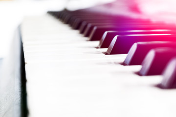 Side view of piano keys. Close-up of piano keys. Close frontal view. Piano keyboard with selective...