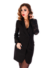 Beautiful young woman in a short black dress