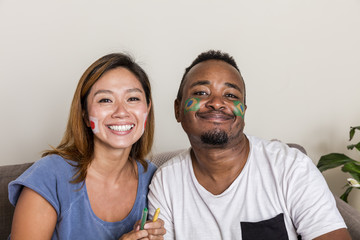 Japanese girl and Brazilian guy with facepainted flags