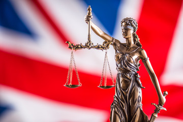 Lady Justice and United Kingdom flag. Symbol of law and justice with UK Flag