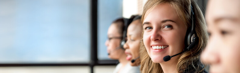 Beautiful caucasian woman working in call center with international colleagues